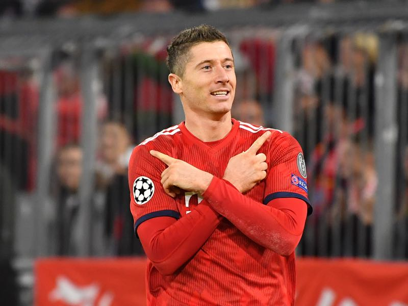 Dortmund vs Bayern - Robert Lewandowski of Bayern Munich celebrates after he scores his sides second goal during the UEFA Champions League Group E match of the between FC Bayern Muenchen and AEK Athens at Fussball Arena Muenchen on November 7, 2018 in Munich, Germany. (Photo by Sebastian Widmann/Bongarts/Getty Images)