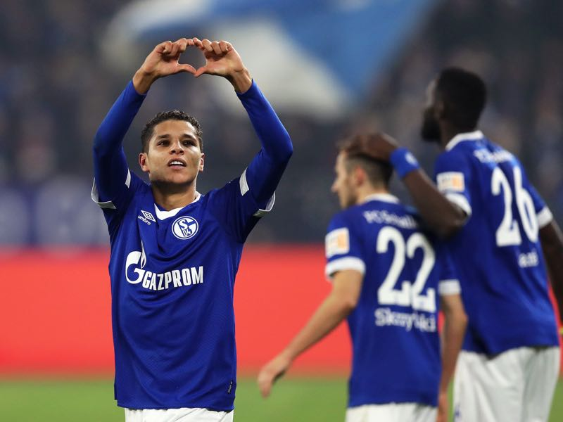Amine Harit celebrates with teammates after scoring his team's second goal during the Bundesliga match between FC Schalke 04 and 1. FC Nuernberg at Veltins-Arena on November 24, 2018 in Gelsenkirchen, Germany. (Photo by Maja Hitij/Bongarts/Getty Images)
