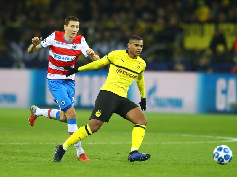 Dortmund v Brugge - Hans Vanaken of Club Brugge battles for possession with Manuel Akanji Borussia Dortmund during the UEFA Champions League Group A match between Borussia Dortmund and Club Brugge at Signal Iduna Park on November 28, 2018 in Dortmund, Germany. (Photo by Martin Rose/Bongarts/Getty Images,)