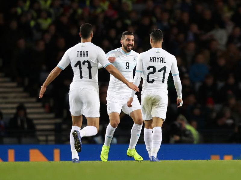 Beram Kayal of Israel celebrates with team mates Loai Taha and Munas Dabbur after scoring his team's first goal during the UEFA Nations League C group one match between Scotland and Israel at Hampden Park on November 20, 2018 in Glasgow, United Kingdom. (Photo by Ian MacNicol/Getty Images)