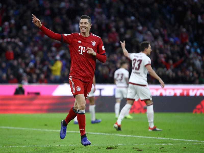 Bayern v Nürnberg - Robert Lewandowski of Bayern Munich celebrates after scoring his team's second goal during the Bundesliga match between FC Bayern Muenchen and 1. FC Nuernberg at Allianz Arena on December 8, 2018 in Munich, Germany. (Photo by Alex Grimm/Bongarts/Getty Images)