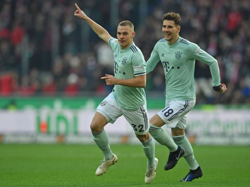 Hannover v Bayern - Joshua Kimmich (L) and Leon Goretzka of Muenchen celebrate their teams first goal during the Bundesliga match between Hannover 96 and FC Bayern Muenchen at HDI-Arena on December 15, 2018 in Hanover, Germany. (Photo by Thomas Starke/Bongarts/Getty Images)