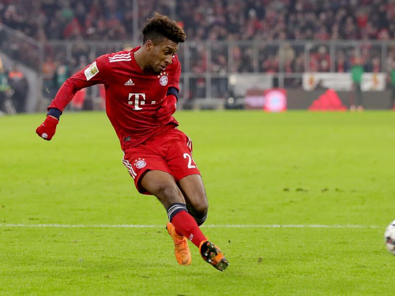 Kingsley Coman of Bayern Muenchen runs with the ball during the Bundesliga match between FC Bayern Muenchen and RB Leipzig at Allianz Arena on December 19, 2018 in Munich, Germany. (Photo by Alexander Hassenstein/Bongarts/Getty Images)