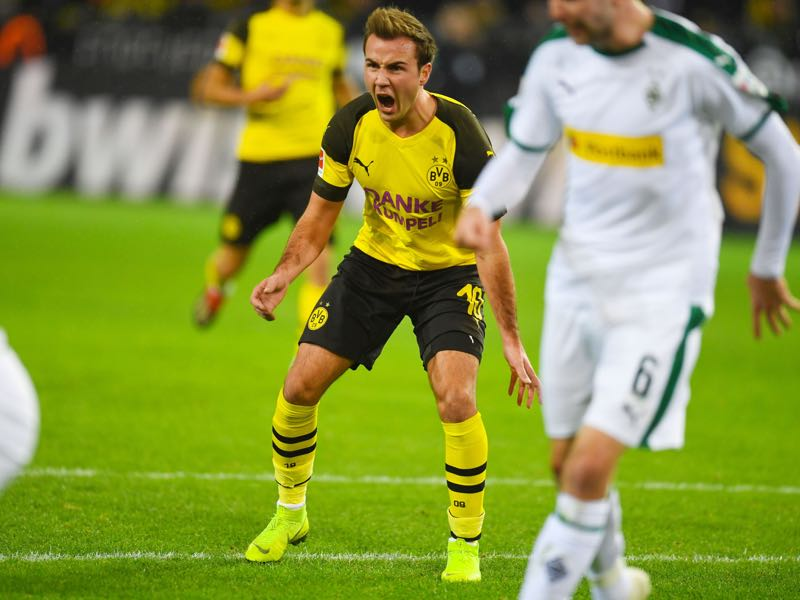 Dortmund v Gladbach - Dortmund's German midfielder Mario Goetze reacts during the German First division Bundesliga football match between Borussia Dortmund and Borussia Moenchengladbach in Dortmund, western Germany, on December 21, 2018. (Photo by Patrik STOLLARZ / AFP)