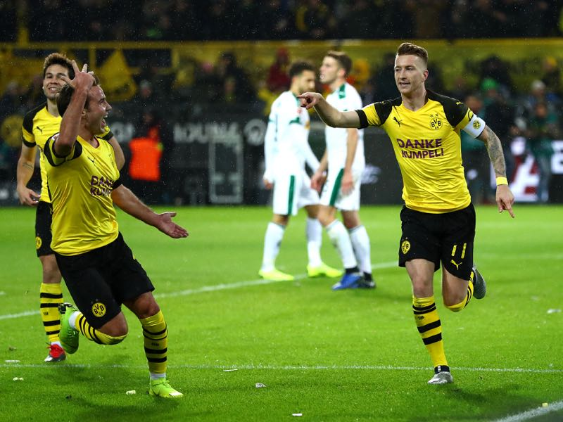 Borussia Dortmund v Gladbach - Marco Reus of Borussia Dortmund (r) celebrates scoring his side's second goal with Mario Gotze of Borussia Dortmund during the Bundesliga match between Borussia Dortmund and Borussia Moenchengladbach at Signal Iduna Park on December 21, 2018 in Dortmund, Germany. (Photo by Lars Baron/Bongarts/Getty Images)