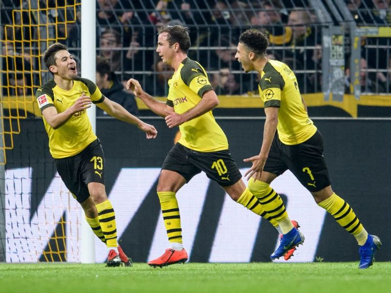 Dortmund v Hannover (L-R) Raphael Guerreiro, Mario Goetze and Jadon Sancho of Dortmund celebrate after the 3-0 lead during the Bundesliga match between Borussia Dortmund and Hannover 96 at the Signal Iduna Park on January 26, 2019 in Dortmund, Germany. (Photo by Jörg Schüler/Getty Images)