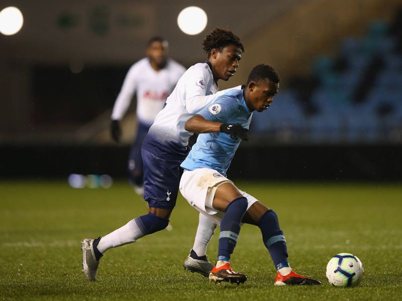 Rabbi Matondo of Manchester City holds off a challenge from Tariq Hinds of Tottenham Hotspur during the Premier League 2 match between Manchester City and Tottenham Hotspur at The Academy Stadium on December 15, 2018 in Manchester, England. (Photo by Alex Livesey/Getty Images)