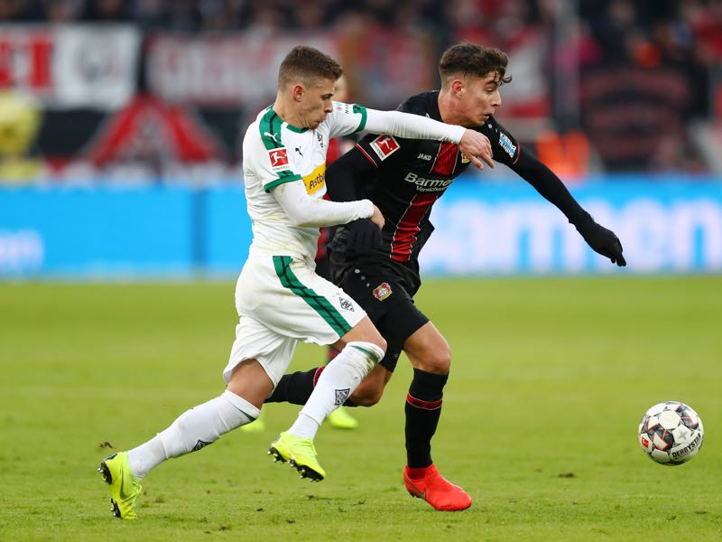 Leverkusen v Gladbach - Kai Havertz of Bayer 04 Leverkusen battles for possesion with Thorgan Hazard of Borussia Monchengladbach during the Bundesliga match between Bayer 04 Leverkusen and Borussia Moenchengladbach at BayArena on January 19, 2019 in Leverkusen, Germany. (Photo by Lars Baron/Bongarts/Getty Images)