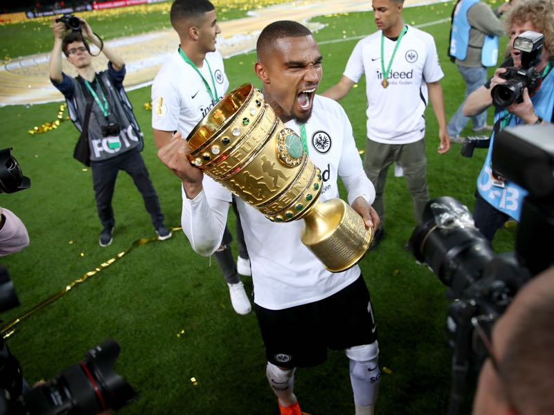 Kevin Prince Boateng celebrates with the DFB Cup trophy after winning the DFB Cup final against Bayern Muenchen at Olympiastadion on May 19, 2018 in Berlin, Germany. (Photo by Lars Baron/Bongarts/Getty Images)