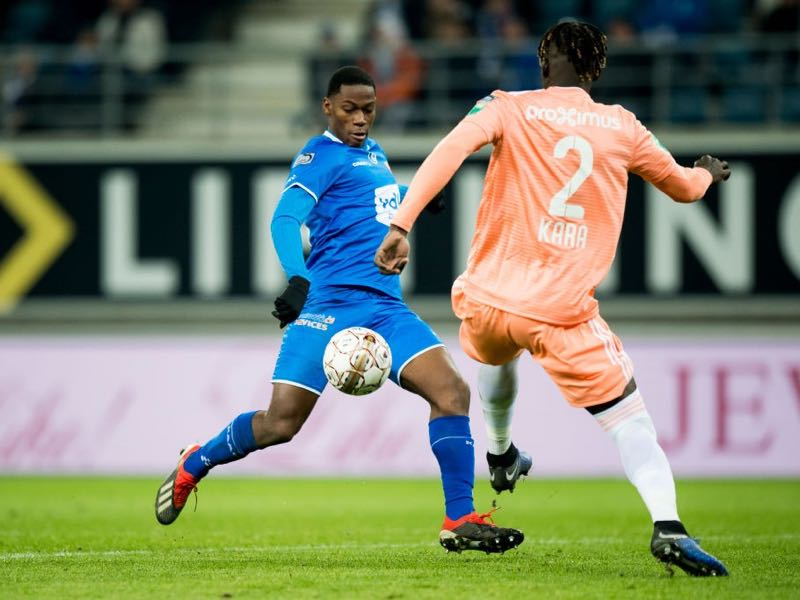 Jonathan David Gent's Jonathan David and Anderlecht's Kara Mbodji fight for the ball during a soccer match between KAA Gent and RSC Anderlecht, Sunday 20 January 2019 in Gent, on day 22 of the 'Jupiler Pro League' Belgian soccer championship season 2018-2019. (JASPER JACOBS/AFP/Getty Images)