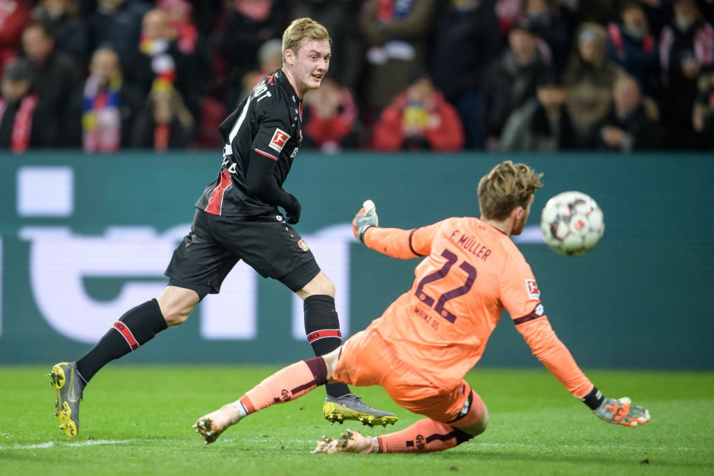Mainz v Leverkusen - Julian Brandt of Leverkusen scores the 1-3 lead against Florian Mueller of Mainz during the Bundesliga match between 1. FSV Mainz 05 and Bayer 04 Leverkusen at the Opel Arena on February 08, 2019 in Mainz, Germany. (Photo by Jörg Schüler/Getty Images)