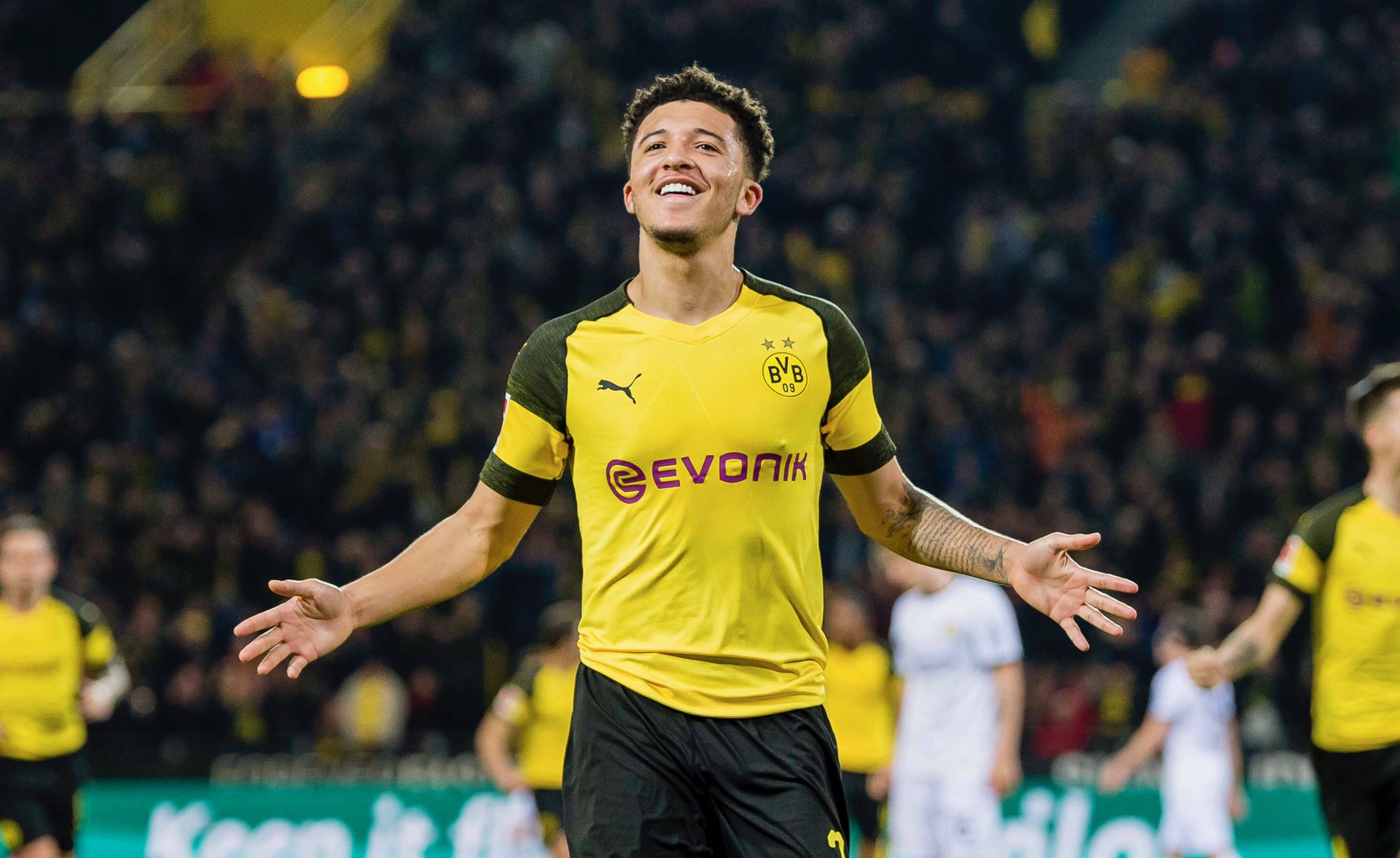 Dortmund's English midfielder Jadon Sancho celebrates scoring their team's second goal during the German first division Bundesliga football match Borussia Dortmund vs Bayer Leverkusen on February 24, 2019 in Dortmund. (Photo by Patrik STOLLARZ / AFP) / DFL REGULATIONS PROHIBIT ANY USE OF PHOTOGRAPHS AS IMAGE SEQUENCES AND/OR QUASI-VIDEO (Photo credit should read PATRIK STOLLARZ/AFP/Getty Images)