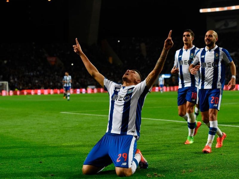 Porto's Brazilian forward Tiquinho Soares celebrates after scoring a goal during the Portuguese league football match FC Porto vs CD Nacional Funchal at the Dragao stadium in Porto on March 4, 2017. / AFP PHOTO / FRANCISCO LEONG