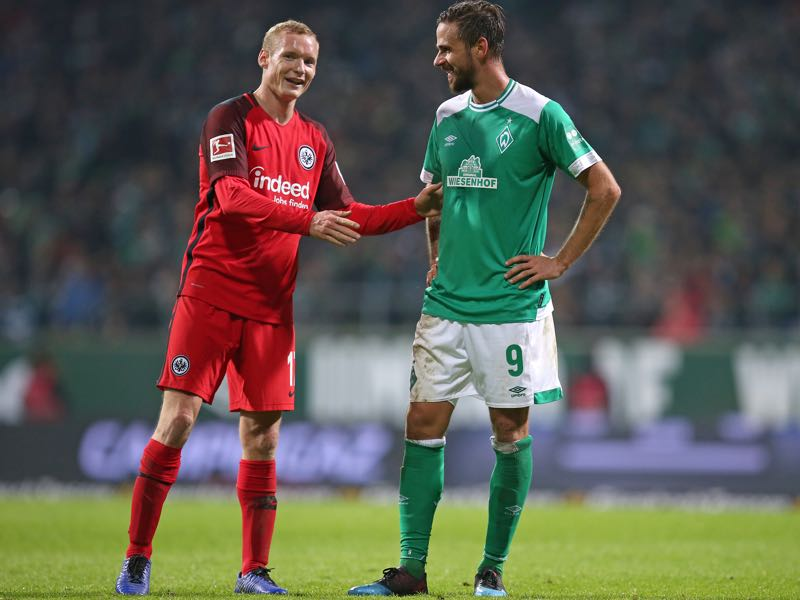 Sebastian Rode of Eintracht Frankfurt and Martin Harnik of Werder Bremen talk to each other during the Bundesliga match between SV Werder Bremen and Eintracht Frankfurt at Weserstadion on January 26, 2019 in Bremen, Germany. (Photo by Cathrin Mueller/Bongarts/Getty Images)