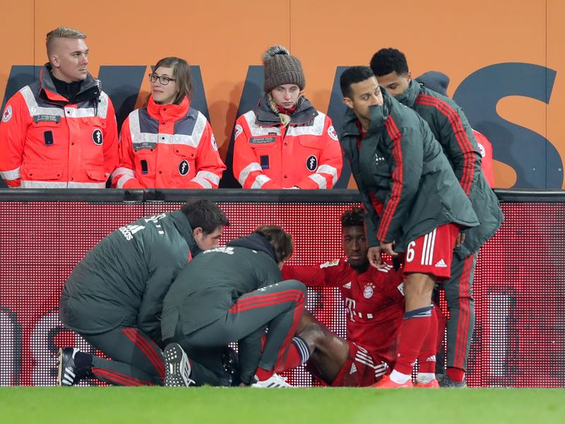 Augsburg v Bayern München - Kingsley Coman of Muenchen sits injured on the pitch during the Bundesliga match between FC Augsburg and FC Bayern Muenchen at WWK-Arena on February 15, 2019 in Augsburg, Germany. (Photo by Alexander Hassenstein/Bongarts/Getty Images)