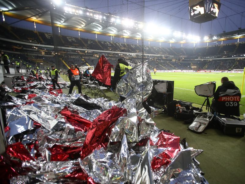 Frankfurt v Shakhtar Donetsk - Flags are seen on the ground after Frankfurt Ultras remove flags from a planned choreography prior to the UEFA Europa League Round of 32 Second Leg match between Eintracht Frankfurt and Shakhtar Donetsk at Commerzbank-Arena on February 21, 2019 in Frankfurt am Main, Germany. (Photo by Alex Grimm/Getty Images)
