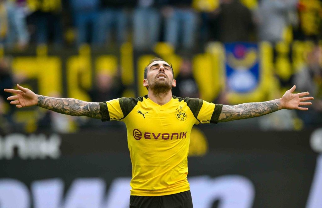 Dortmund's Spanish forward Paco Alcacer celebrates scoring 2 - 0 during the German first division Bundesliga football match Borussia Dortmund v VfL Wolfsburg on March 30, 2019 in Dortmund. (Photo by SASCHA SCHUERMANN / AFP) / RESTRICTIONS: DFL REGULATIONS PROHIBIT ANY USE OF PHOTOGRAPHS AS IMAGE SEQUENCES AND/OR QUASI-VIDEO (Photo credit should read SASCHA SCHUERMANN/AFP/Getty Images)