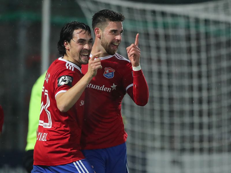 Stefan Schimmer of SpVgg Unterhaching celebrates his team`s second goal with his teammate Markus Schwabl of SpVgg Unterhaching during the 3. Liga match between SpVgg Unterhaching and 1. FC Kaiserslautern at Alpenbauer Sportpark on November 30, 2018 in Unterhaching, Germany. (Photo by Christian Kaspar-Bartke/Bongarts/Getty Images)