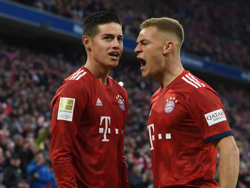 Bayern v Wolfsburg - Bayern Munich's midfielder Joshua Kimmich (R) and Bayern Munich's Colombian James Rodriguez (L) react after their third goal during the German first division Bundesliga football match Bayern Munich vs VfL Wolfsburg on March 9, 2019 in Munich. (Photo by Christof STACHE / AFP)