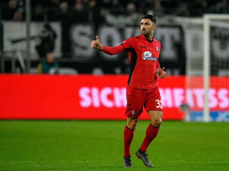 Freiburg's Italian midfielder Vincenzo Grifo celebrates scoring the opening goal during the German first division Bundesliga football match Borussia Moenchengladbach v SC Freiburg in Moenchengladbach, western Germany on March 15, 2019. (Photo by SASCHA SCHUERMANN / AFP) /