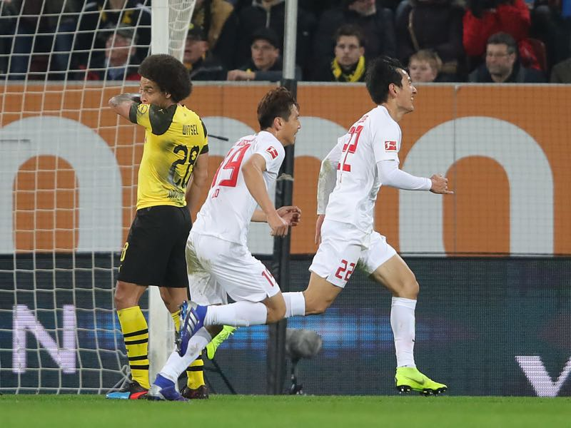 Augsburg v Dortmund - Ji Dong-Won of Augsburg celebrates scoring his teams first goal during the Bundesliga match between FC Augsburg and Borussia Dortmund at WWK-Arena on March 01, 2019 in Augsburg, Germany. (Photo by Alexander Hassenstein/Bongarts/Getty Images)