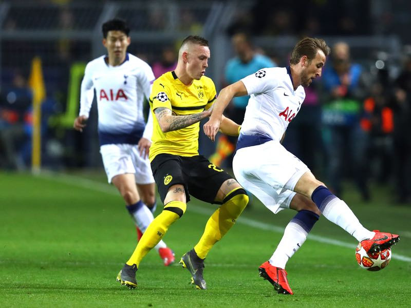 Dortmund v Tottenham - Marius Wolf of Borussia Dortmund tackles Harry Kane of Tottenham Hotspur during the UEFA Champions League Round of 16 Second Leg match between Borussia Dortmund and Tottenham Hotspur at Westfalen Stadium on March 05, 2019 in Dortmund, North Rhine-Westphalia. (Photo by Maja Hitij/Bongarts/Getty Images)