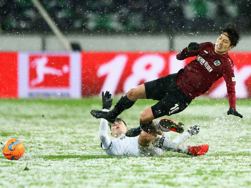 Hannover v Leverkusen - Genki Haraguchi of Hannover 96 is tackled by Kai Havertz of Bayer 04 Leverkusen during the Bundesliga match between Hannover 96 and Bayer 04 Leverkusen at HDI-Arena on March 10, 2019 in Hanover, Germany. (Photo by Martin Rose/Bongarts/Getty Images)