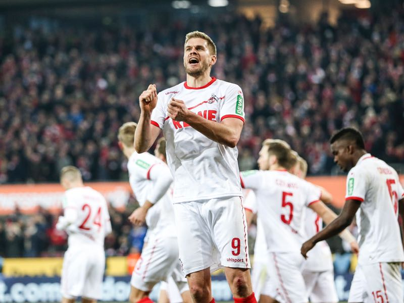 Simon Terodde #9 of 1. FC Koeln celebrates with his teammates after scoring his team fourth goal during the Second Bundesliga match between 1. FC Koeln and FC St. Pauli at RheinEnergieStadion on February 08, 2019 in Cologne, Germany. (Photo by Maja Hitij/Bongarts/Getty Images)