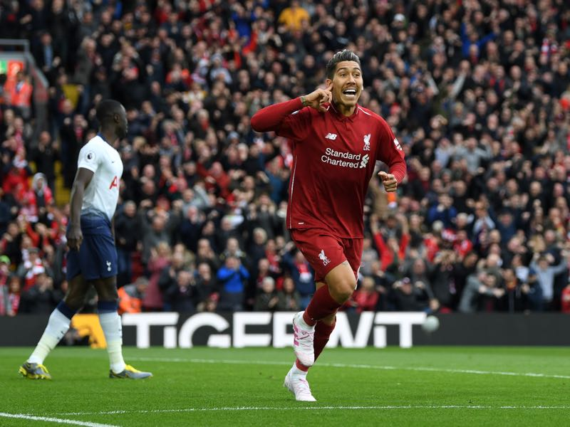 Roberto Firminho of Liverpool celebrates after he scores his sides first goal during the Premier League match between Liverpool FC and Tottenham Hotspur at Anfield on March 31, 2019 in Liverpool, United Kingdom. (Photo by Shaun Botterill/Getty Images)