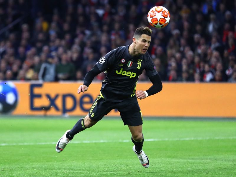 Cristiano Ronaldo of Juventus scores his team's first goal during the UEFA Champions League Quarter Final first leg match between Ajax and Juventus at Johan Cruyff Arena on April 10, 2019 in Amsterdam, Netherlands. (Photo by Michael Steele/Getty Images)