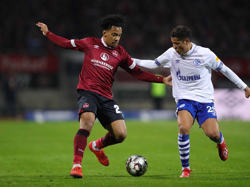 Nürnberg v Schalke -Matheus Pereira of FC Nuernberg competes for the ball with Amine Harit of FC Schalke 04during the Bundesliga match between 1. FC Nuernberg and FC Schalke 04 at Max-Morlock-Stadion on April 12, 2019 in Nuremberg, Germany. (Photo by Alexander Hassenstein/Bongarts/Getty Images)