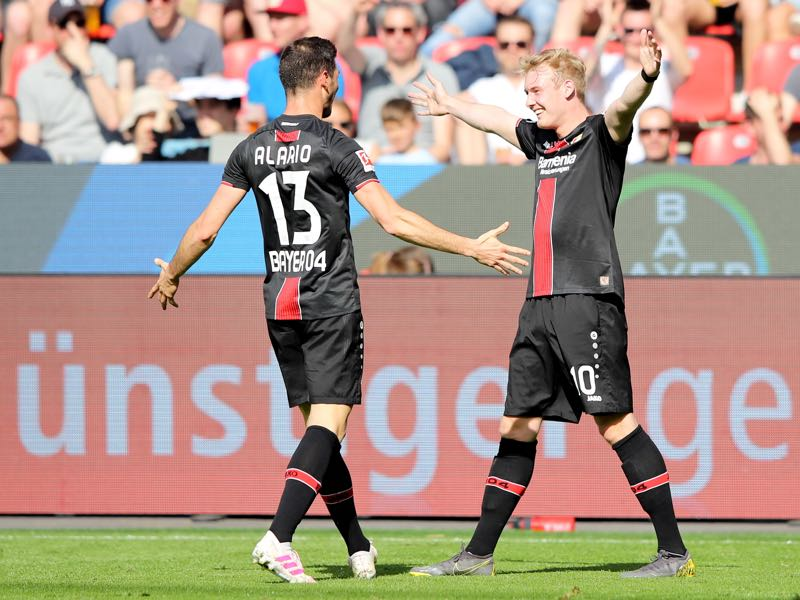 Bayer Leverkusen v Nürnberg - Lucas Alario of Bayer 04 Leverkusen celebrates after scoring his team's first goal with teammate Julian Brandt during the Bundesliga match between Bayer 04 Leverkusen and 1. FC Nuernberg at BayArena on April 20, 2019 in Leverkusen, Germany. (Photo by Christof Koepsel/Bongarts/Getty Images)
