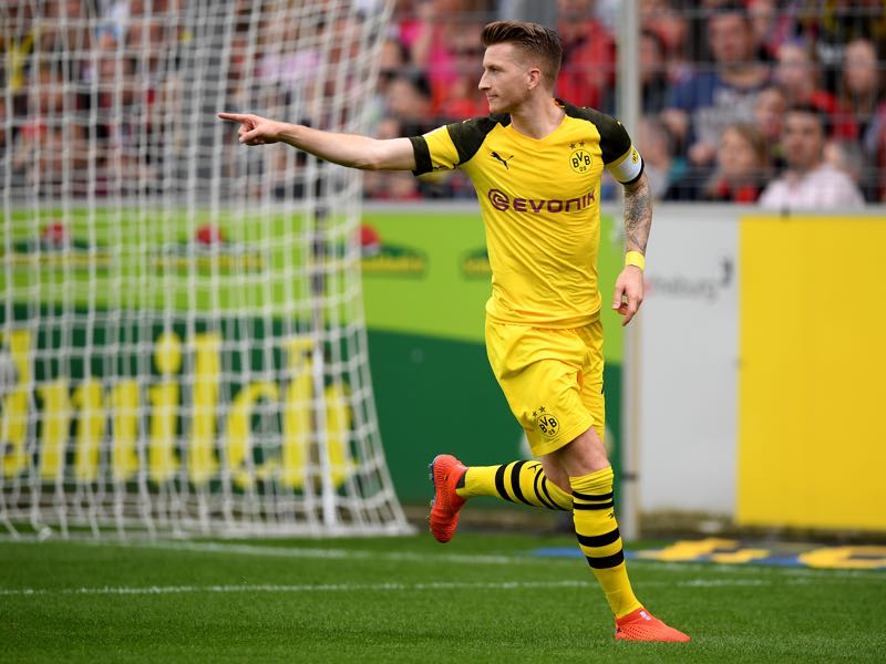 Freiburg v Borussia Dortmund - Marco Reus of Dortmund celebrates after he scores the 2nd goal during the Bundesliga match between Sport-Club Freiburg and Borussia Dortmund at Schwarzwald-Stadion on April 21, 2019 in Freiburg im Breisgau, Germany. (Photo by Christian Kaspar-Bartke/Bongarts/Getty Images)
