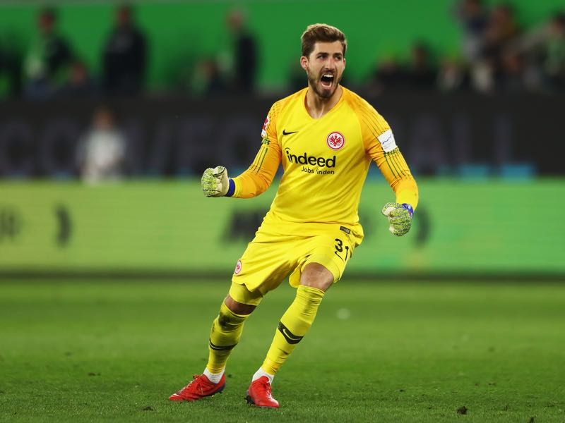 Wolfsburg v Eintracht Frankfurt - Goalkeeper, Kevin Trapp of Eintracht Frankfurt celebrates the goal scored by Jonathan de Guzman during the Bundesliga match between VfL Wolfsburg and Eintracht Frankfurt at Volkswagen Arena on April 22, 2019 in Wolfsburg, Germany. (Photo by Martin Rose/Bongarts/Getty Images)