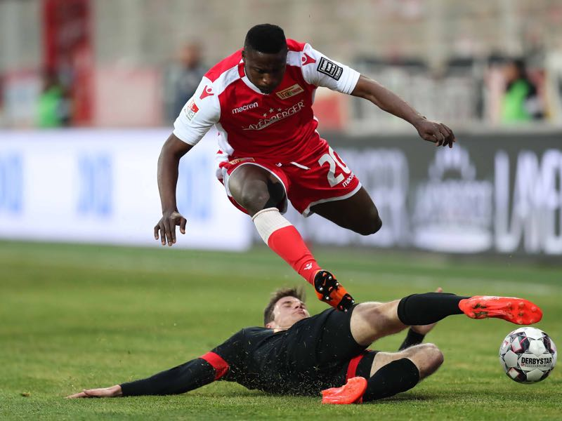 Suleiman Abdullahi of FC Union Berlin is challenged by Maximilian Thalhammer of SSV Jahn Regensburg during the Second Bundesliga match between 1. FC Union Berlin and SSV Jahn Regensburg at Stadion An der Alten Foersterei on April 12, 2019 in Berlin, Germany. (Photo by Boris Streubel/Bongarts/Getty Images)