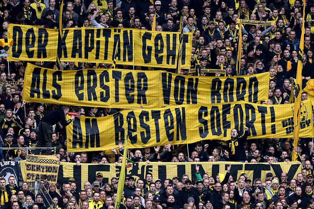 "Fans in the Dortmund stand show a banner ""Der Kapitaen geht als erster von Bord. Am besten sofort!"" according to Mats Hummels during the Bundesliga match between Borussia Dortmund and VfL Wolfsburg at Signal Iduna Park on April 29, 2016 in Dortmund, Germany. (Photo by Sascha Steinbach/Bongarts/Getty Images)"
