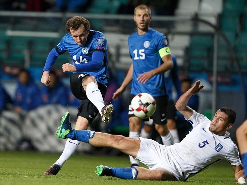 Estonia's Konstantin Vassiljev (L) shoots on goal during the WC 2018 football qualification match between Estonia and Greece in Tallinn on October 10, 2016. ( RAUL MEE/AFP/Getty Images)