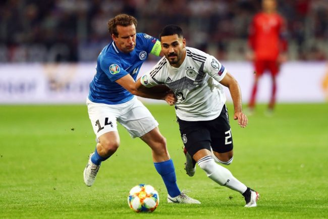 IIkay Gundogan of Germany battles with Konstantin Vassiljev of Estonia during the UEFA Euro 2020 Qualifier match between Germany and Estonia at Opel Arena on June 11, 2019 in Mainz, Germany. (Photo by Martin Rose/Bongarts/Getty Images)