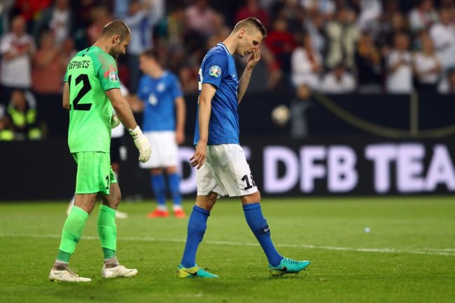 Goal keeper Sergei Lepmets of Estonia and Karol Mets of Estonia look on dejected at the final whistle during the UEFA Euro 2020 Qualifier match between Germany and Estonia at Opel Arena on June 11, 2019 in Mainz, Germany. (Photo by Martin Rose/Bongarts/Getty Images)