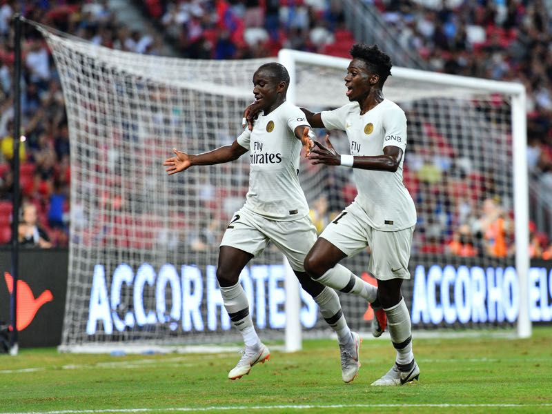 Moussa Diaby and team mate Timothy Weah of Paris Saint Germain celebrates his goal during the International Champions Cup match between Paris Saint Germain and Clu b de Atletico Madrid at the National Stadium on July 30, 2018 in Singapore. (Photo by Thananuwat Srirasant/Getty Images for ICC)