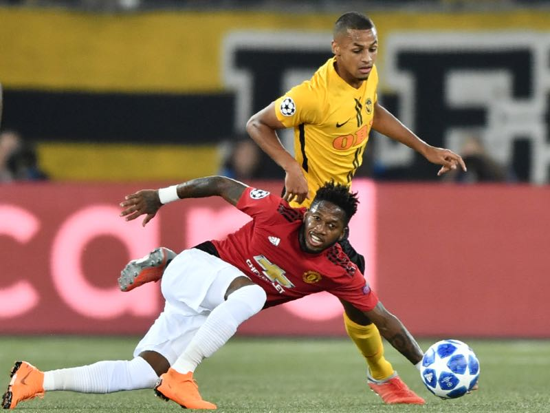 Young Boys Swiss midfielder Djibril Sow (R) fights for the ball with Manchester United's Brazilian midfielder Fred (C) during the UEFA Champions League group H football match between Young Boys and Manchester United at The Stade de Suisse in Bern on September 19, 2018. (Photo by Fabrice COFFRINI / AFP)