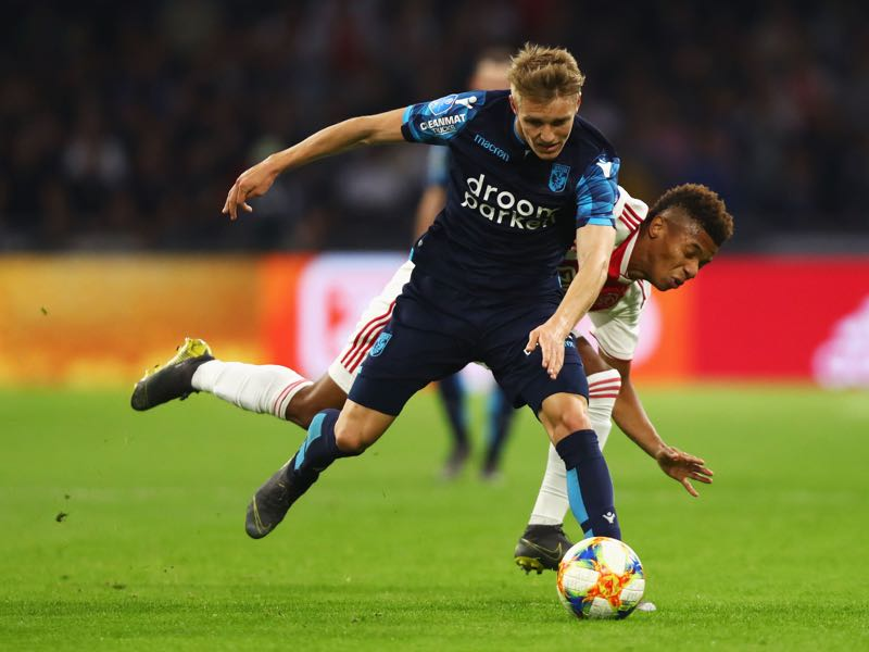 Martin Ødegaard of Vitesse battles for the ball with David Neres of Ajax during the Eredivisie match between Ajax and Vitesse at Johan Cruyff Arena on April 23, 2019 in Amsterdam, Netherlands. (Photo by Dean Mouhtaropoulos/Getty Images)