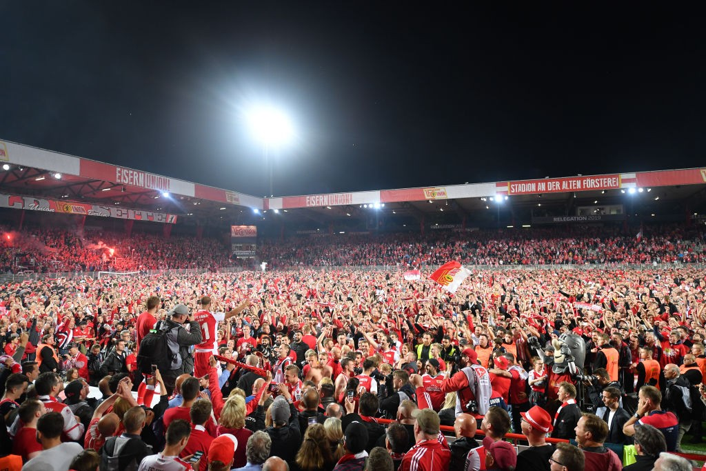 Fans of Union Berlin celebrate after the Bundesliga playoff second leg match between 1. FC Union Berlin and VfB Stuttgart at Stadion an der alten Försterei on May 27, 2019 in Berlin, Germany. (Photo by Stuart Franklin/Bongarts/Getty Images)