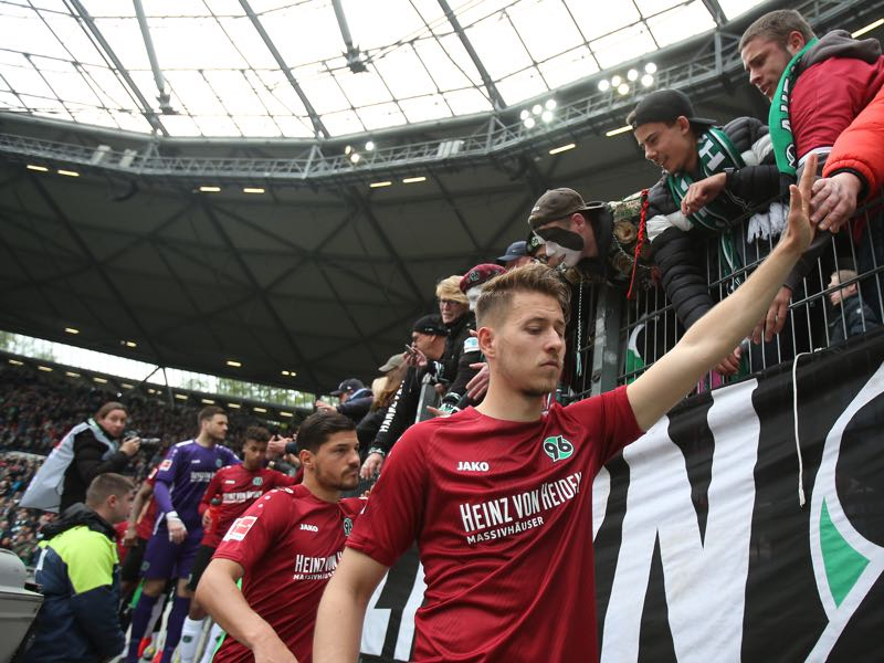 Miiko Albornoz and Waldemar Anton of Hannover 96 go to their fans and thanks them for their support after the Bundesliga match between Hannover 96 and Sport-Club Freiburg at HDI-Arena on May 11, 2019 in Hanover, Germany. (Photo by Cathrin Mueller/Bongarts/Getty Images)
