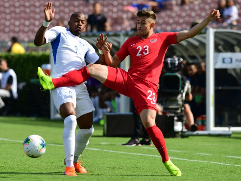 Canada's defender Marcus Godinho (R) vies for the ball with Martinique's forward Kevin Fortune (L) on June 15, 2019 during their opening round 2019 Concacaf Gold Cup match at the Rose Bowl in Pasadena, California. (Photo by Frederic J. BROWN / AFP)