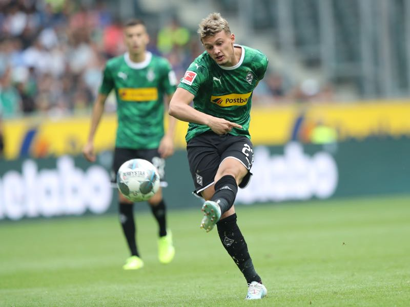 Michaël Cuisance of Moenchengladbach runs with the ball during the pre-season friendly match between Borussia Moenchengladbach and FC Chelsea at Borussia-Park on August 03, 2019 in Moenchengladbach, Germany. The match between Moenchengladbach and Chelsea ended 2-2. (Photo by Christof Koepsel/Bongarts/Getty Images)