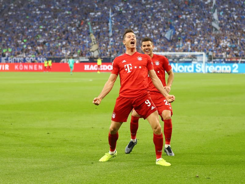 Schalke v Bayern Munich - Robert Lewandowski of FC Bayern Munich celebrates after scoring his team's second goal during the Bundesliga match between FC Schalke 04 and FC Bayern Muenchen at Veltins-Arena on August 24, 2019 in Gelsenkirchen, Germany. (Photo by Martin Rose/Bongarts/Getty Images)