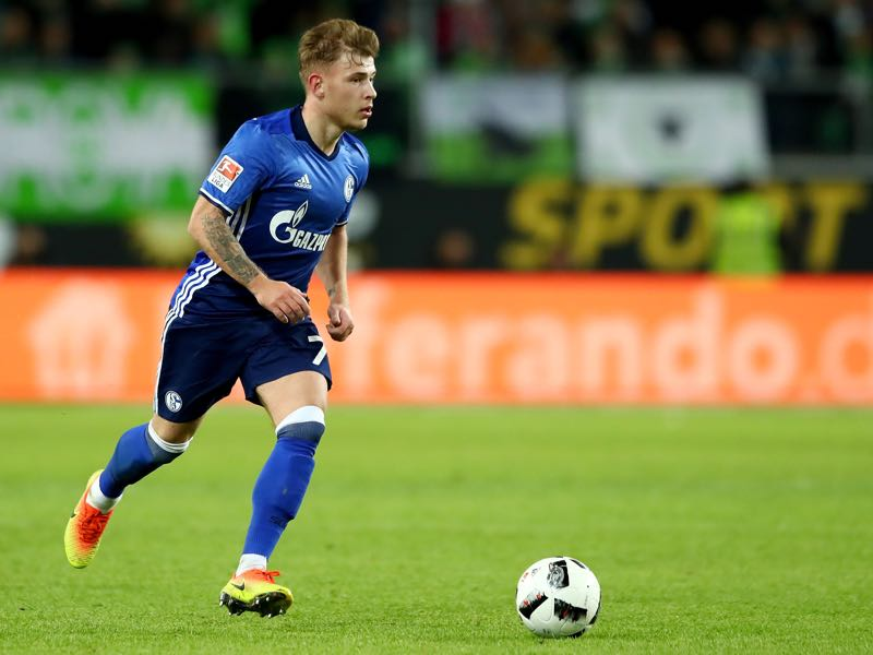 Max Meyer of Schalke runs with the ball during the Bundesliga match between VfL Wolfsburg and FC Schalke 04 at Volkswagen Arena on November 19, 2016 in Wolfsburg, Germany. (Photo by Martin Rose/Bongarts/Getty Images)