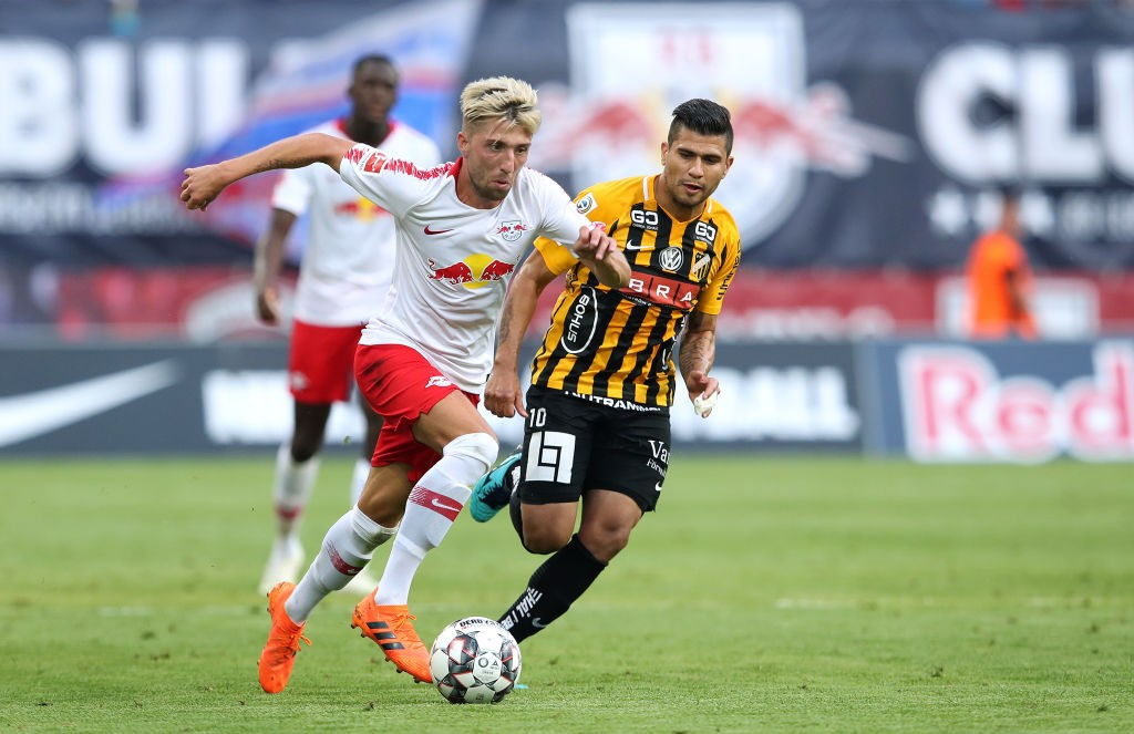 LEIPZIG, GERMANY - JULY 26: Kevin Kampl (L) of RB Leipzig and Paulinho (R) of BK Haecken compete during the UEFA Europa League Qualifier leg one match between RB Leipzig and BK Haecken at Red Bull Arena on July 26, 2018 in Leipzig, Germany. (Photo by Ronny Hartmann/Bongarts/Getty Images)