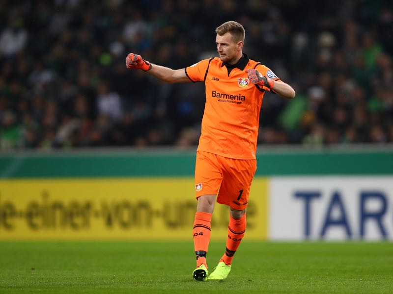 Lukas Hradecky of Bayer Leverkusen celebrates after his team mate Julian Brandt of Bayer Leverkusen (not pictured) scores their side's first goal during the DFB Cup match between Borussia Moenchengladbach and Bayer 04 Leverkusen at Borussia-Park on October 31, 2018 in Moenchengladbach, Germany. (Photo by Dean Mouhtaropoulos/Bongarts/Getty Images)
